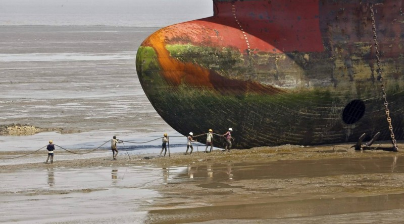 Workers carry a rope line to fasten a decommissioned ship at the Alang shipyard in the western Indian state of Gujarat, March 27, 2015. The European Union plans to impose strict new rules on how companies scrap old tankers and cruise liners, run aground and dismantled on beaches in South Asia. However the practice in India, Bangladesh and Pakistan, hazardous for humans and the environment, will still be hard to stop. European, Turkish and Chinese recyclers are set to benefit from the revamped standards. Depending on raw material prices, ship owners can make up to $500 per tonne of steel from an Indian yard, compared with $300 in China and just $150 in Europe.   REUTERS/Amit Dave    TPX IMAGES OF THE DAY  PICTURE 4 OF 21 FOR WIDER IMAGE STORY 'CLEANING UP SHIPBREAKING'  SEARCH 'SHIPBREAKING' FOR ALL 21 IMAGES